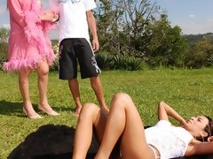 An adventurous couple nail a hot blonde tranny babe outdoors