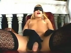 Hot shemale in stockings sucks cock