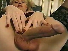 Mature shemale plays with her cock
