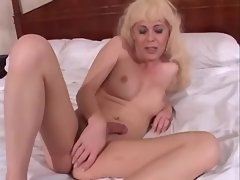 Lonely shemale plays with big dildo